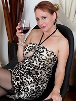 Tiffany T. sips her glass of wine in front of the fireplace and slides her cheetah dress all the way up. Her hairy pussy pops out of her sexy panties.